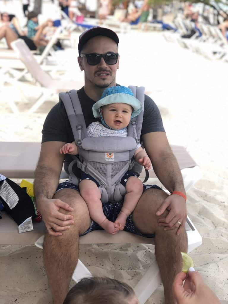 baby carrier at the beach