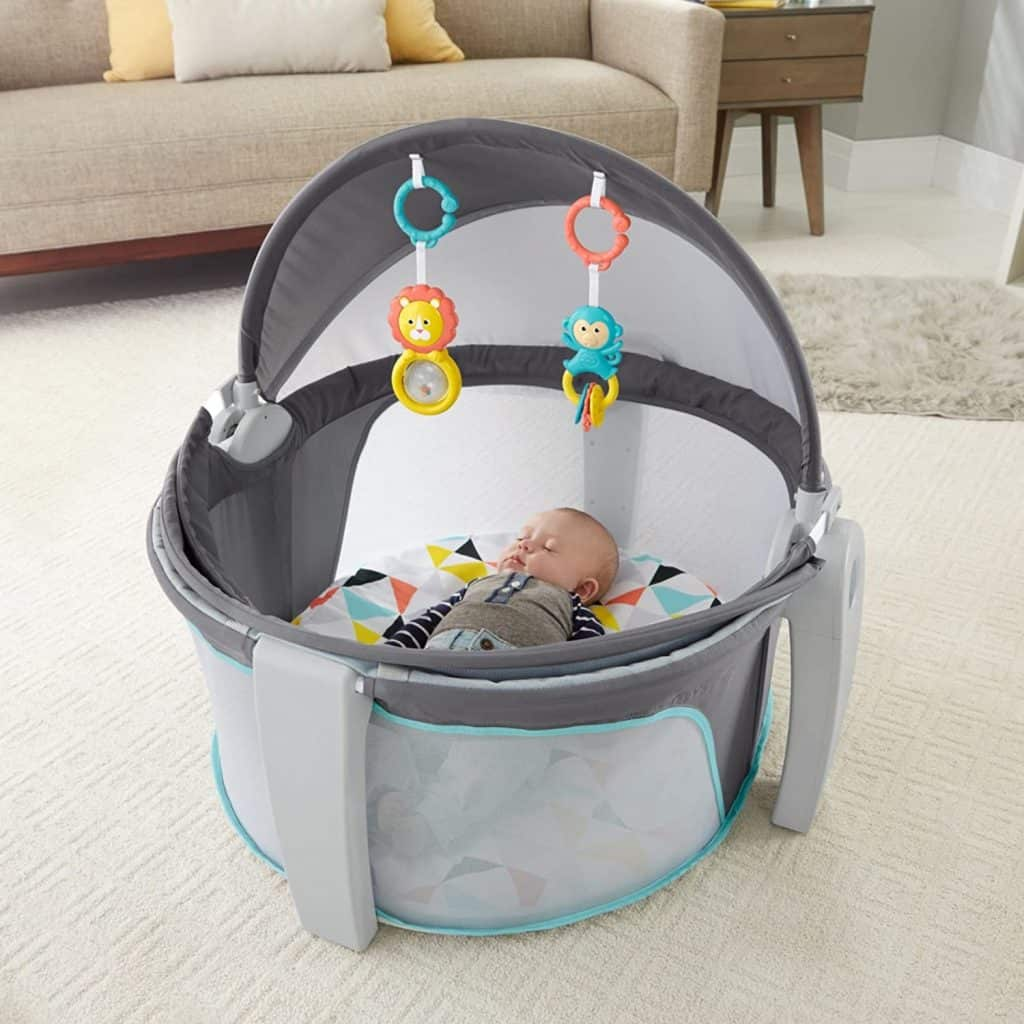 fisher price baby dome with baby sleeping