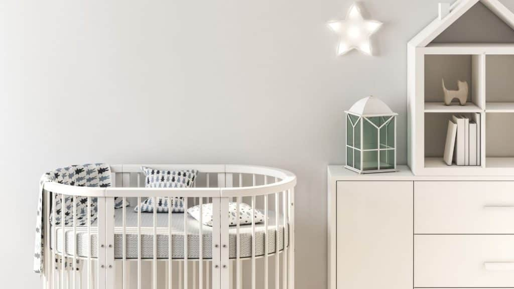 mini crib with rounded sides and mattress