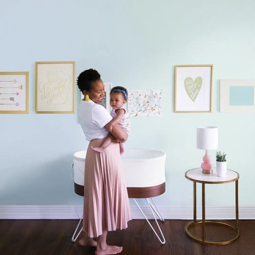 mom and baby with snoo smart sleeper rental