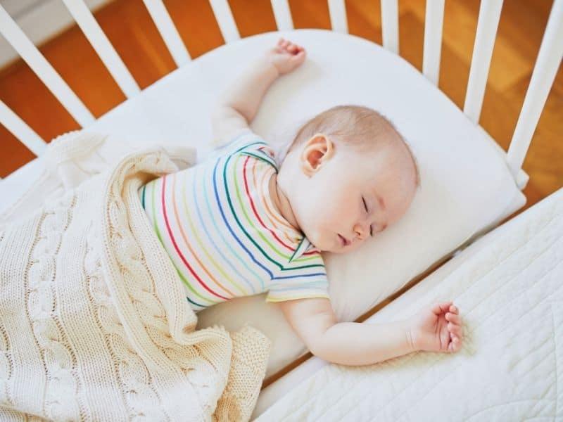 Baby sleeping in a cosleeper