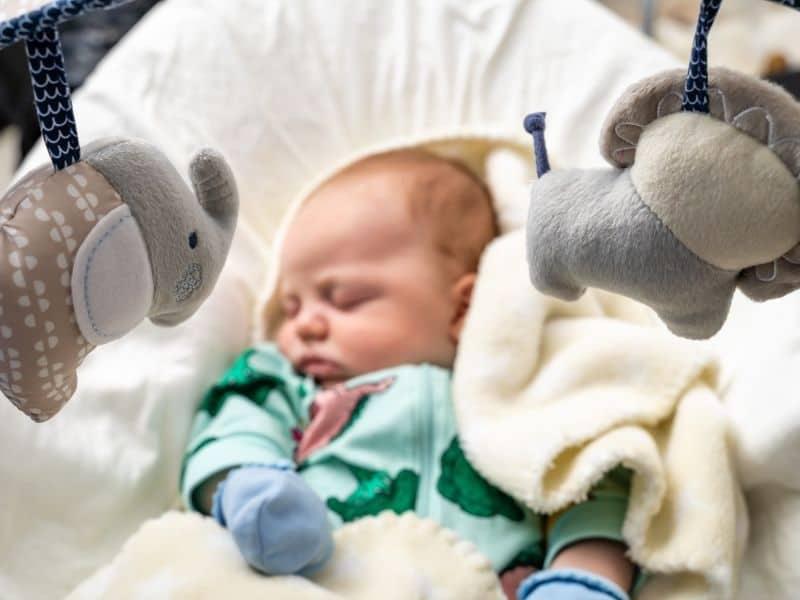 baby sleep on a baby swing
