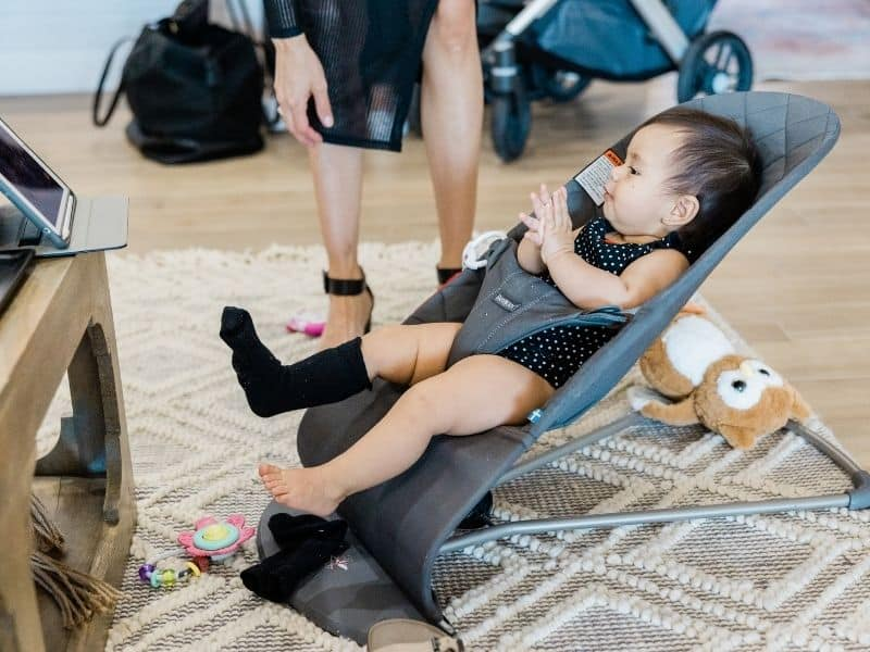 baby resting in a bouncer